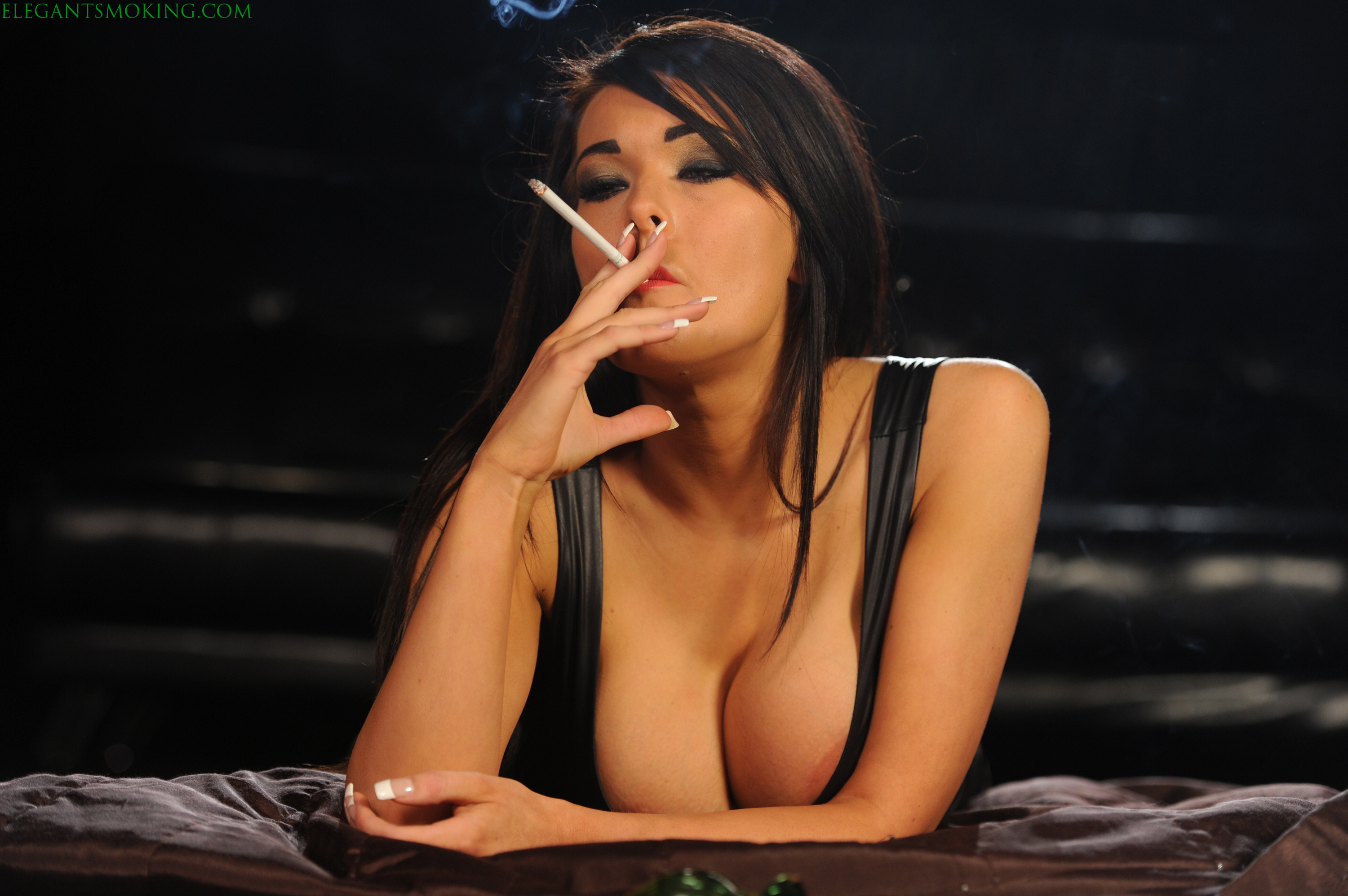 Hot brunette smoking 120s and playing 2
