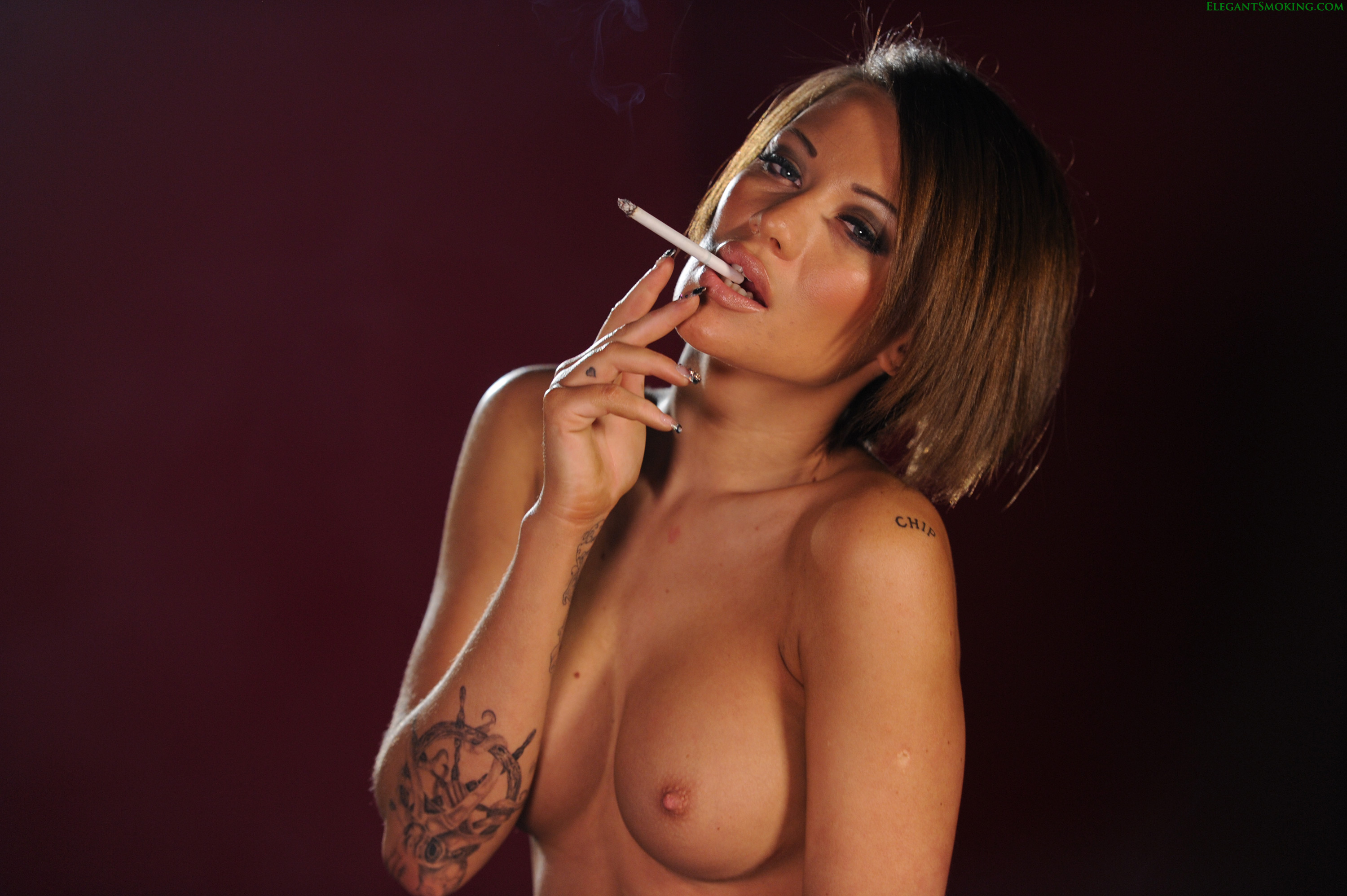 Big boob woman smoking